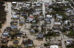 Photo Credit: (Photo: Aerial photo of flooding in the costal town of Loiza, on the north shore of Puerto Rico/Credit: Dennis M. Rivera Pichardo for the Washington Post)