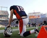 Tebow prays before the Denver/Pittsburgh game