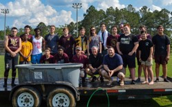 18 Football Players Baptized School's Football Field:
